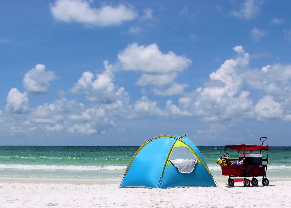 A tent and buggy on a beach : Free Stock Photo