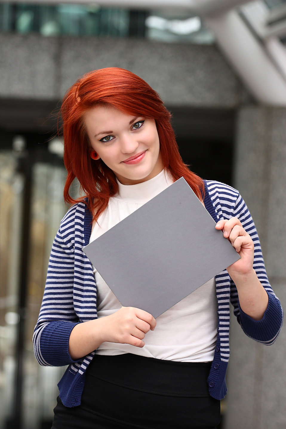 A beautiful young woman holding a blank card : Free Stock Photo