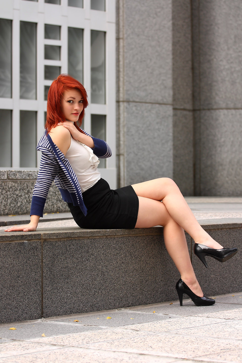 A beautiful young woman in business attire : Free Stock Photo