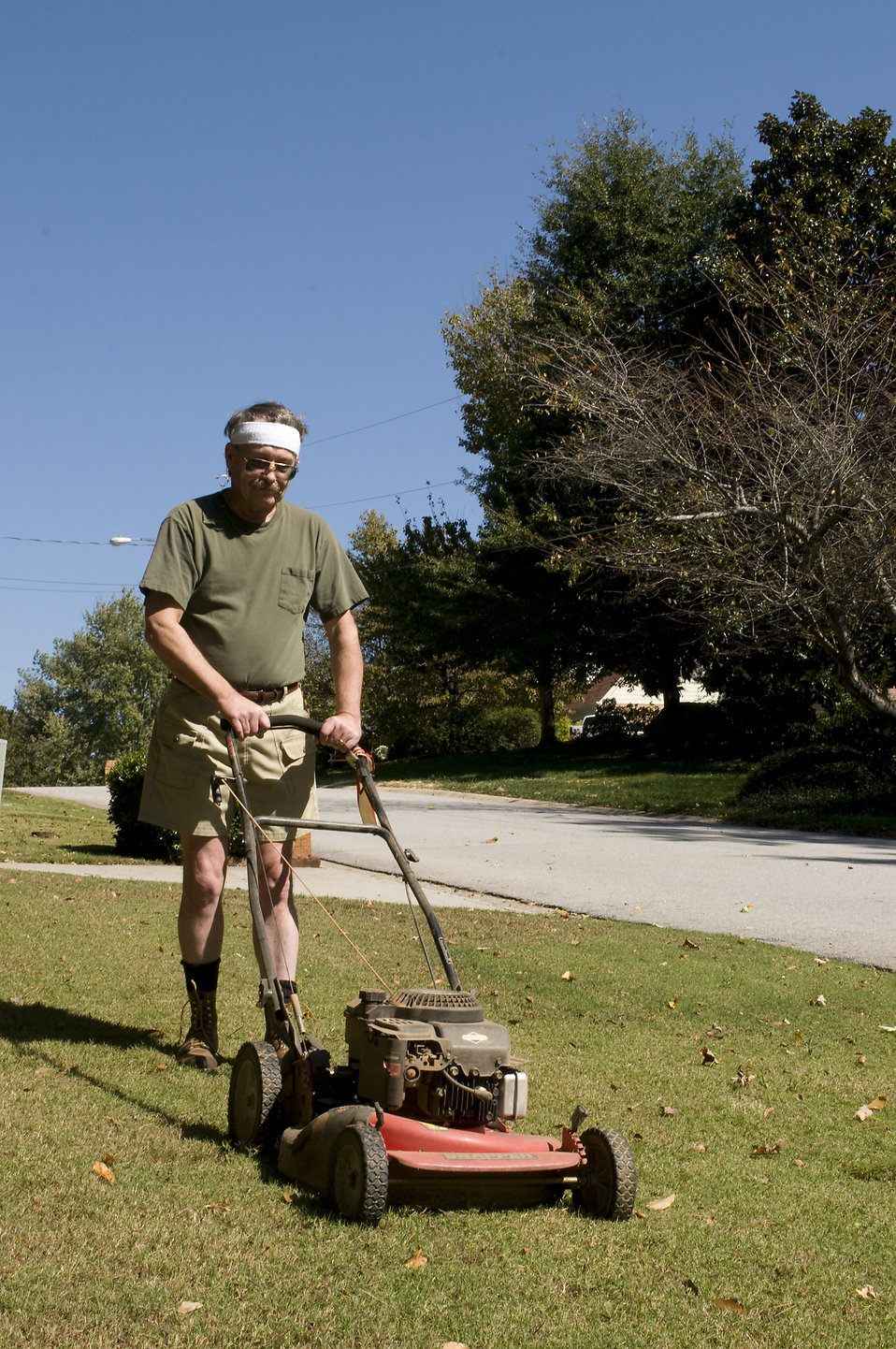 A man mowing a lawn : Free Stock Photo