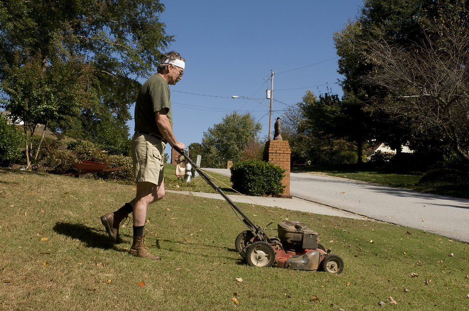 A man mowing a lawn : Free Stock Photo