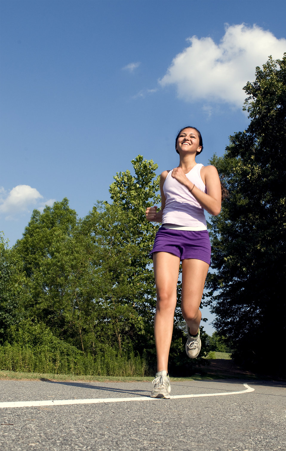 A young woman jogging outdoors : Free Stock Photo