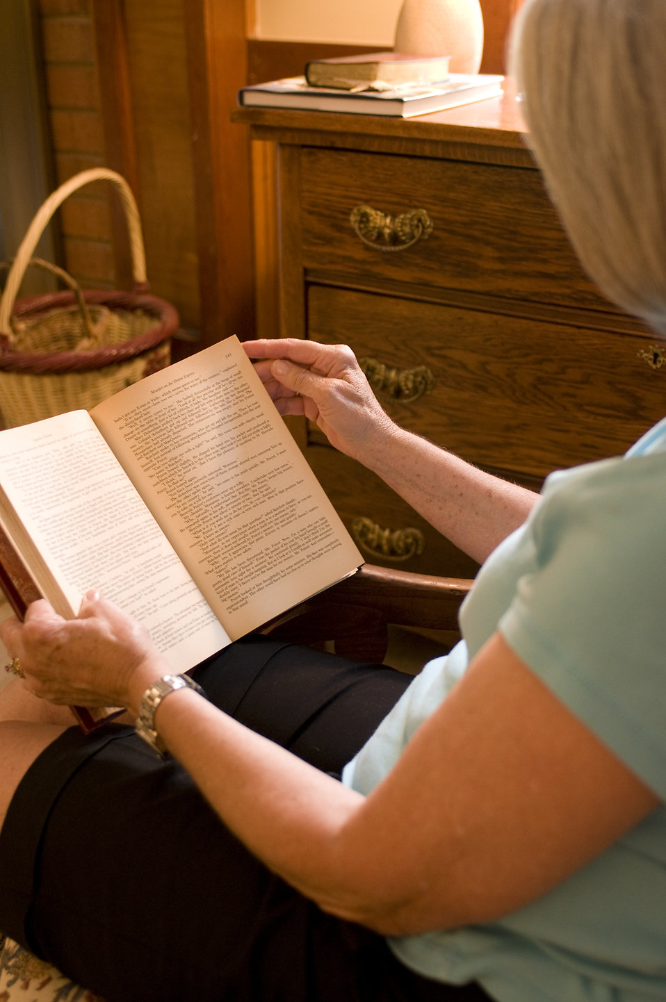 A woman reading a book in her home : Free Stock Photo