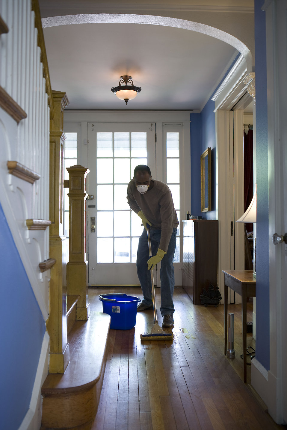 An African-American man mopping his home floor : Free Stock Photo