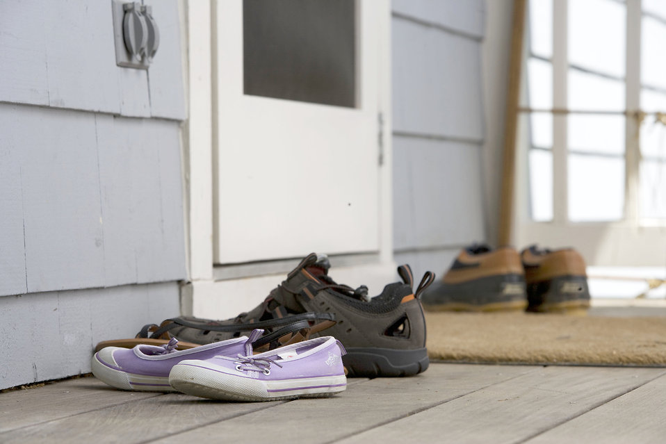 Pairs of shoes on a door mat : Free Stock Photo