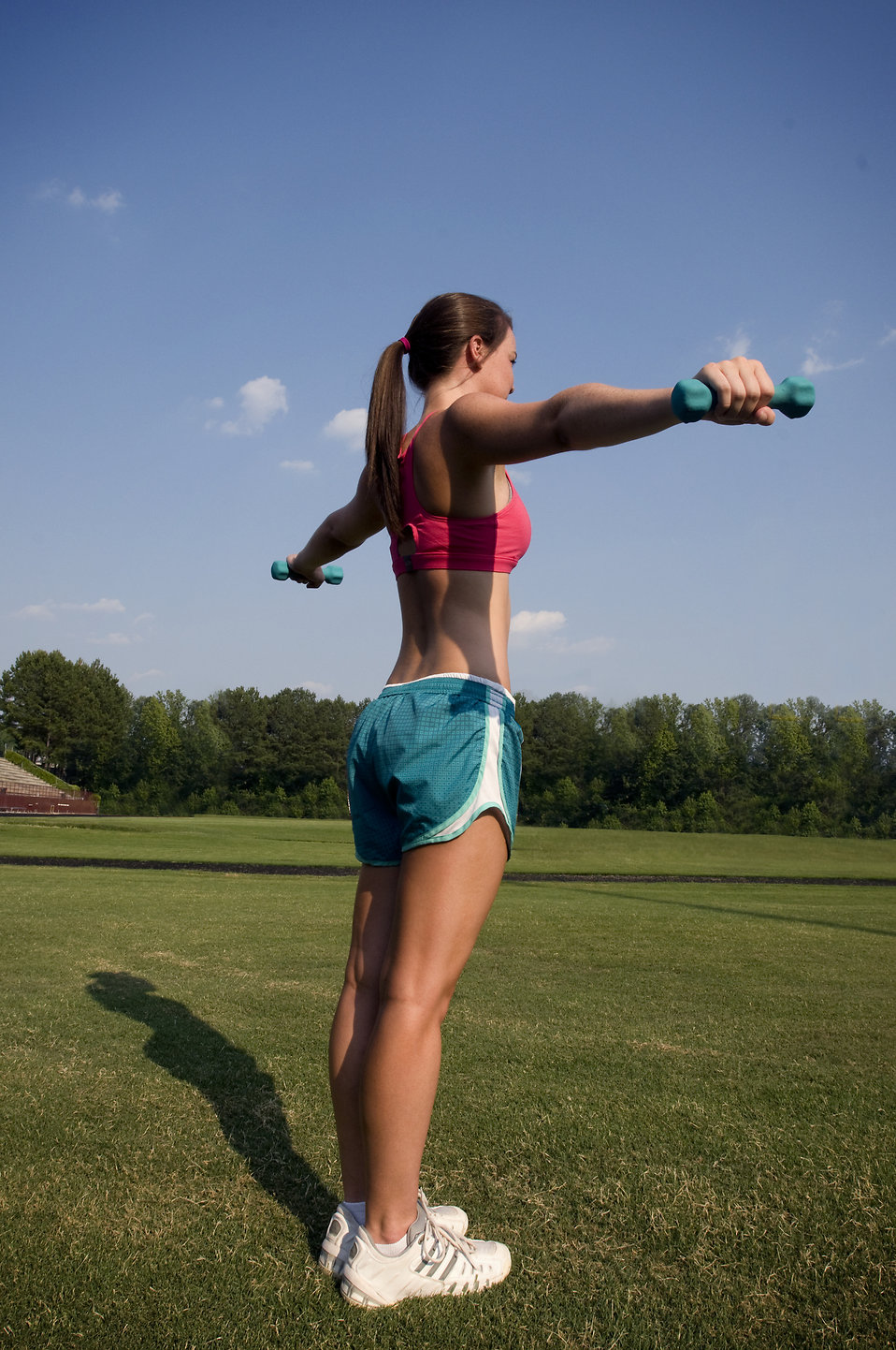 A healthy young woman warming up for exercise outdoors : Free Stock Photo