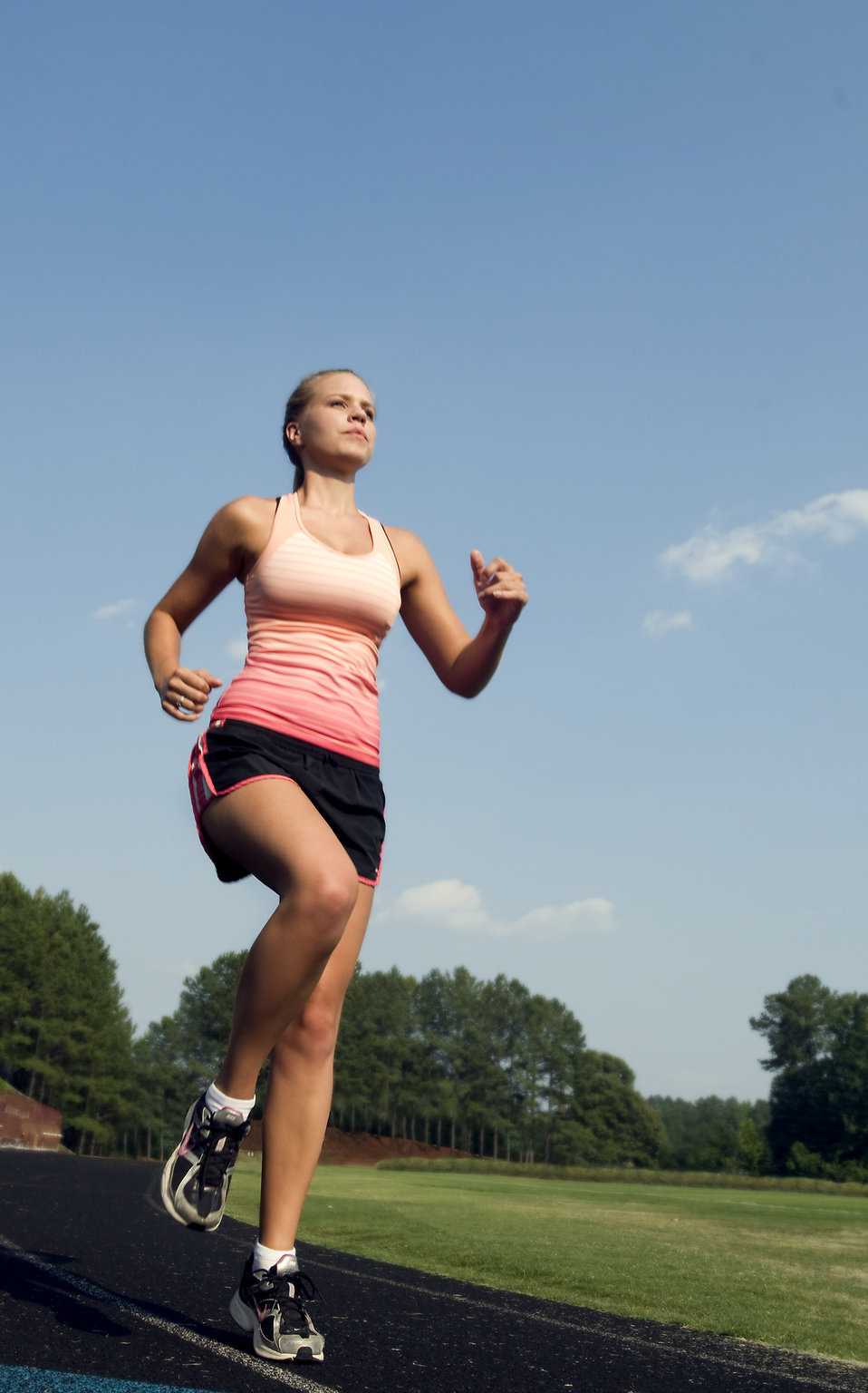 A healthy young woman running outdoors on a track : Free Stock Photo