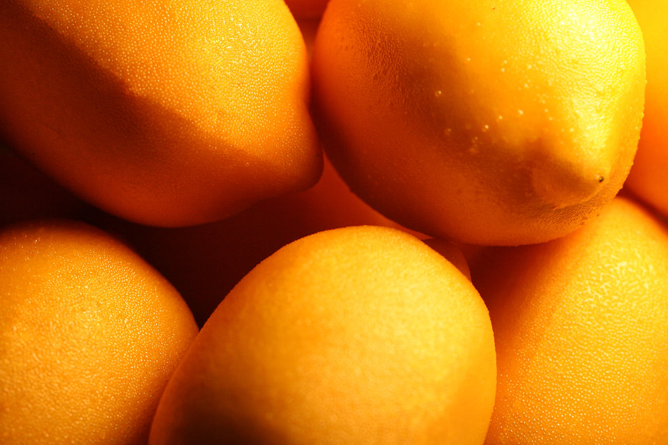 Closeup of bright yellow lemons : Free Stock Photo