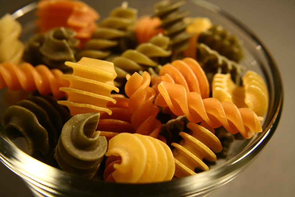 Uncooked rotini pasta on a counter : Free Stock Photo