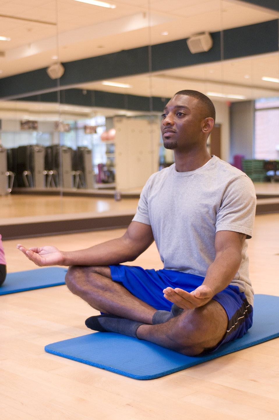 A man practicing yoga in a fitness center : Free Stock Photo