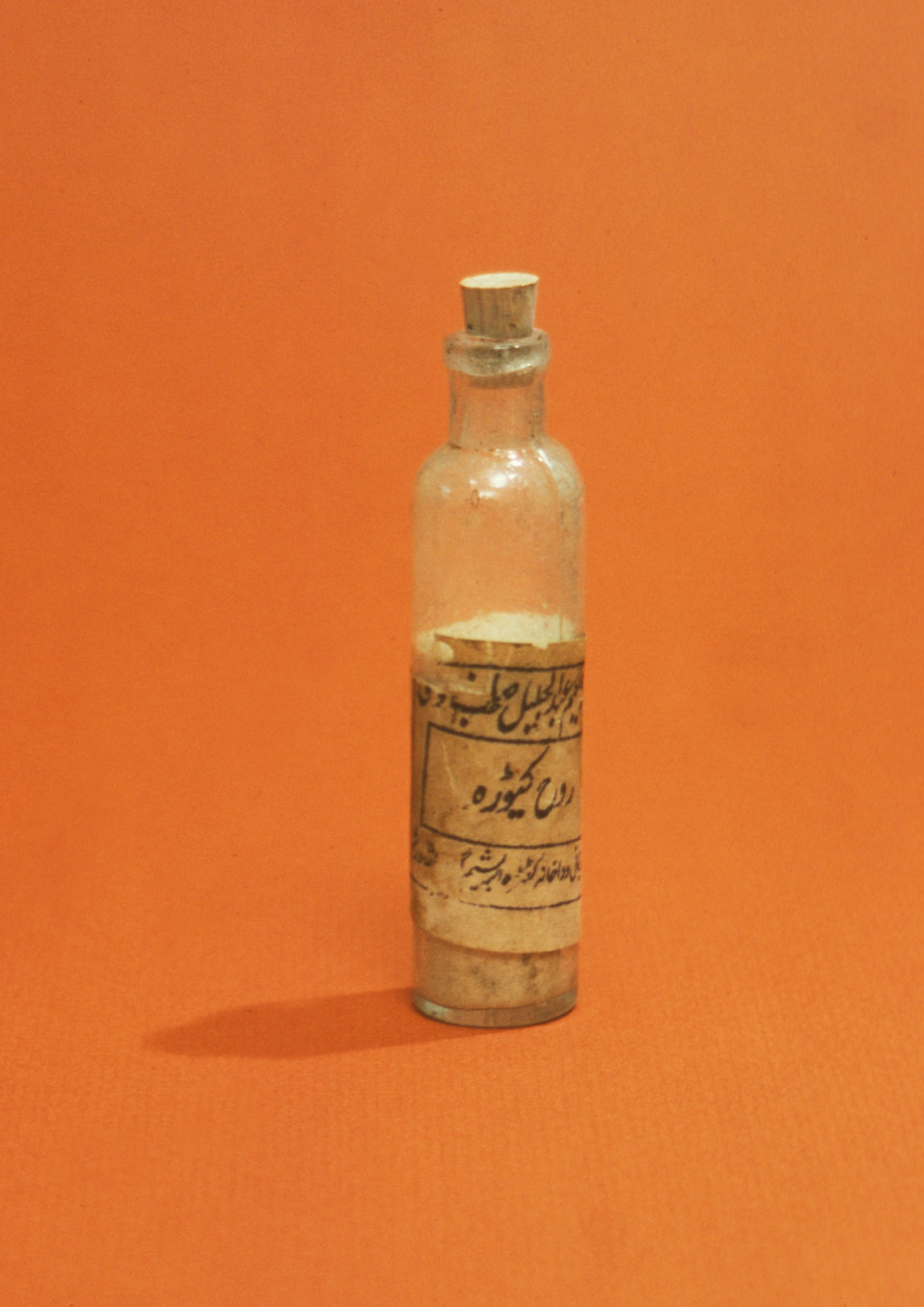 A bottle with medicine isolated on an orange background : Free Stock Photo