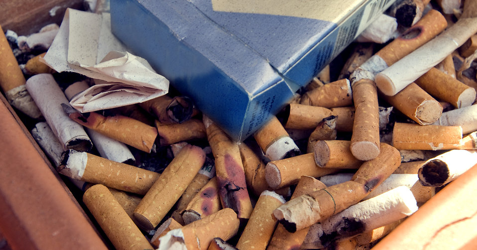 An ashtray filled with cigarette butts : Free Stock Photo