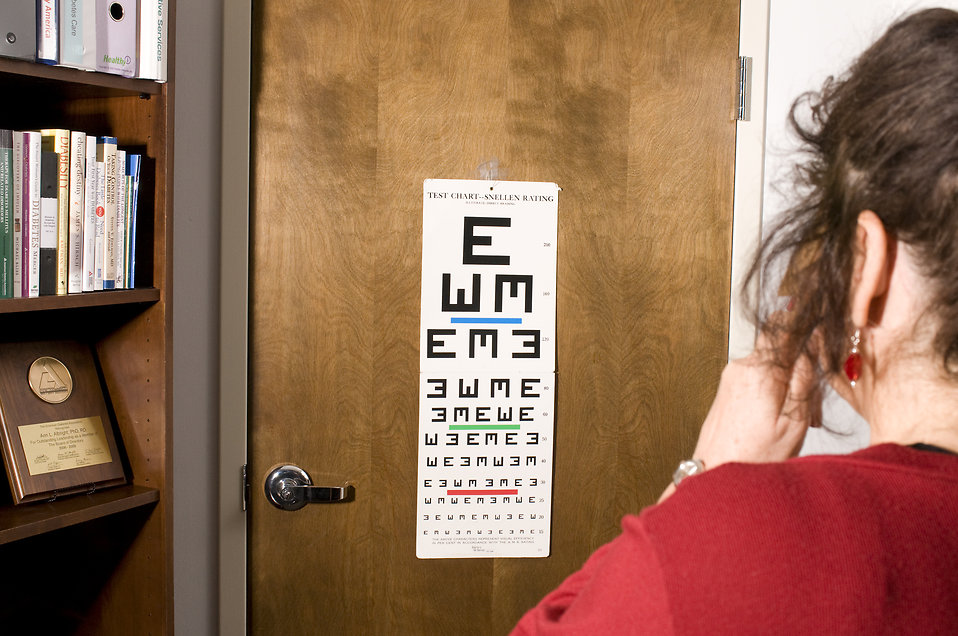 A woman being given an eye exam : Free Stock Photo