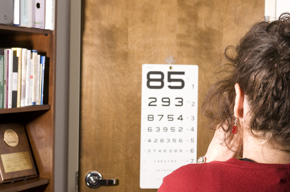 A woman taking an eye exam : Free Stock Photo