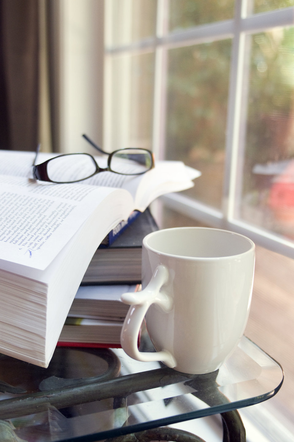 A cup of coffee with a stack of books : Free Stock Photo