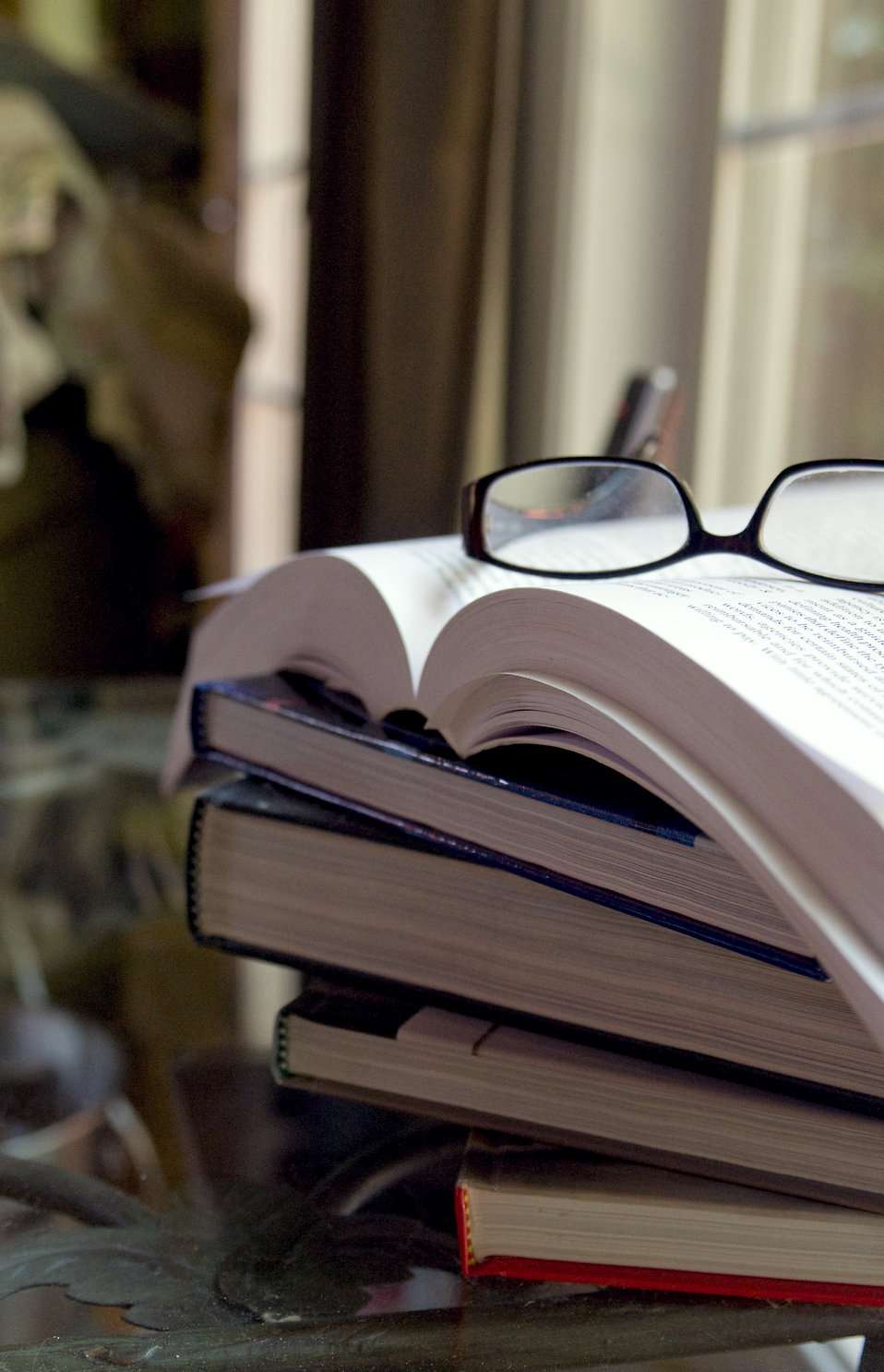A pair of glasses with a stack of books : Free Stock Photo