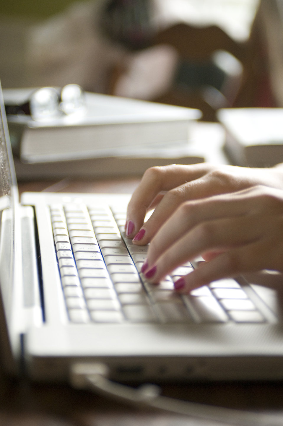 Female hands typing on a laptop keyboard : Free Stock Photo