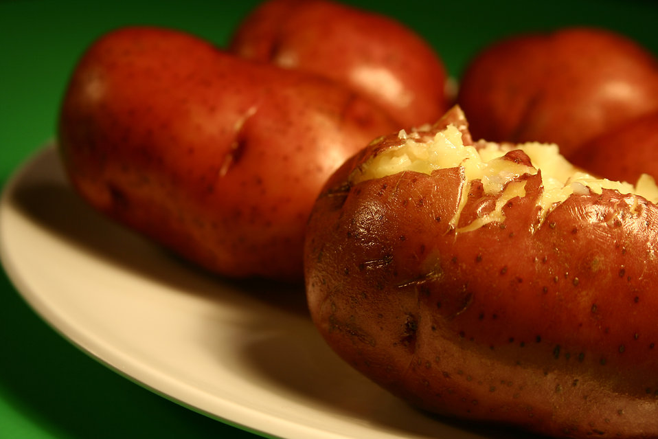 Close up of a plate of baked potatoes : Free Stock Photo