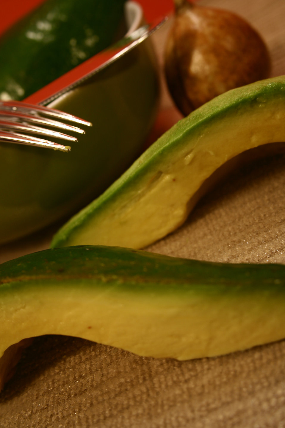 Cut avocado slices and a fork : Free Stock Photo