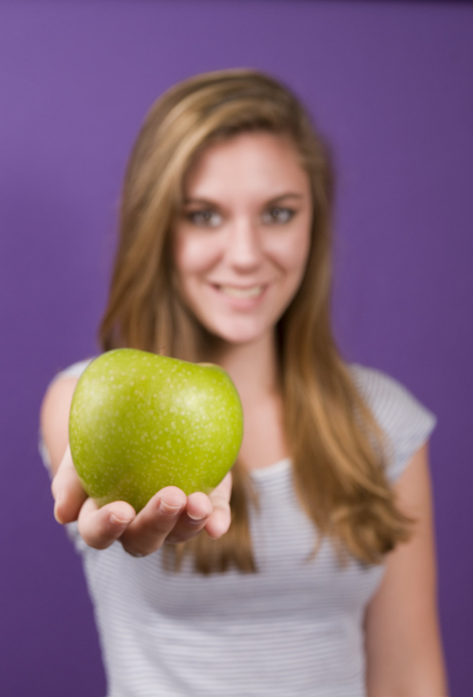 A young woman holding a green apple : Free Stock Photo