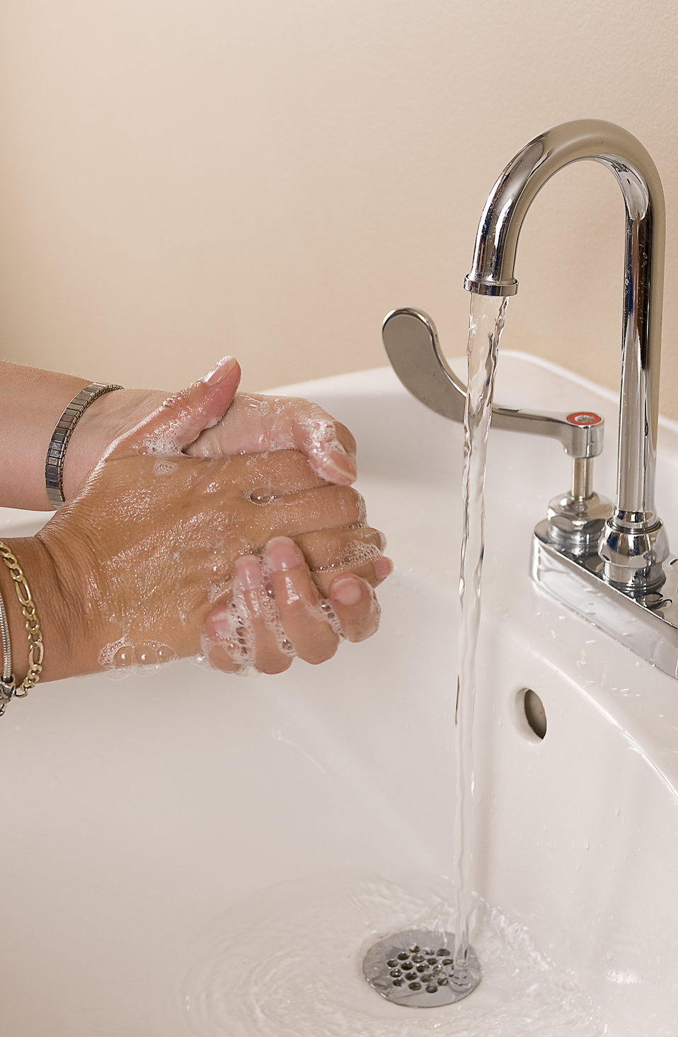 Hands being washed in a sink : Free Stock Photo