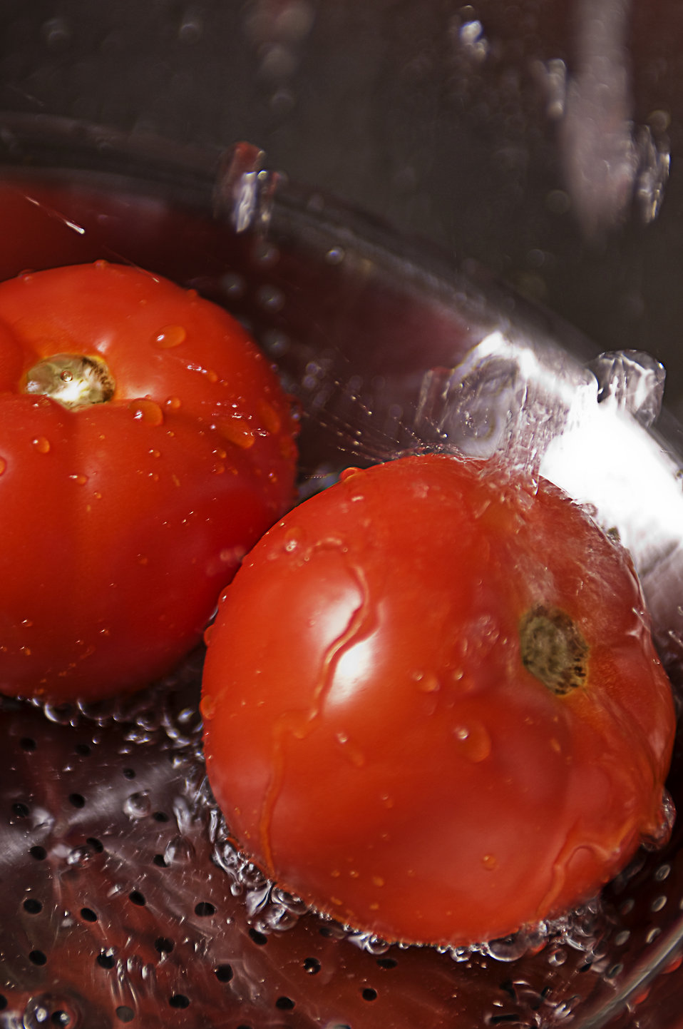 Two fresh tomatoes being washed under running water : Free Stock Photo
