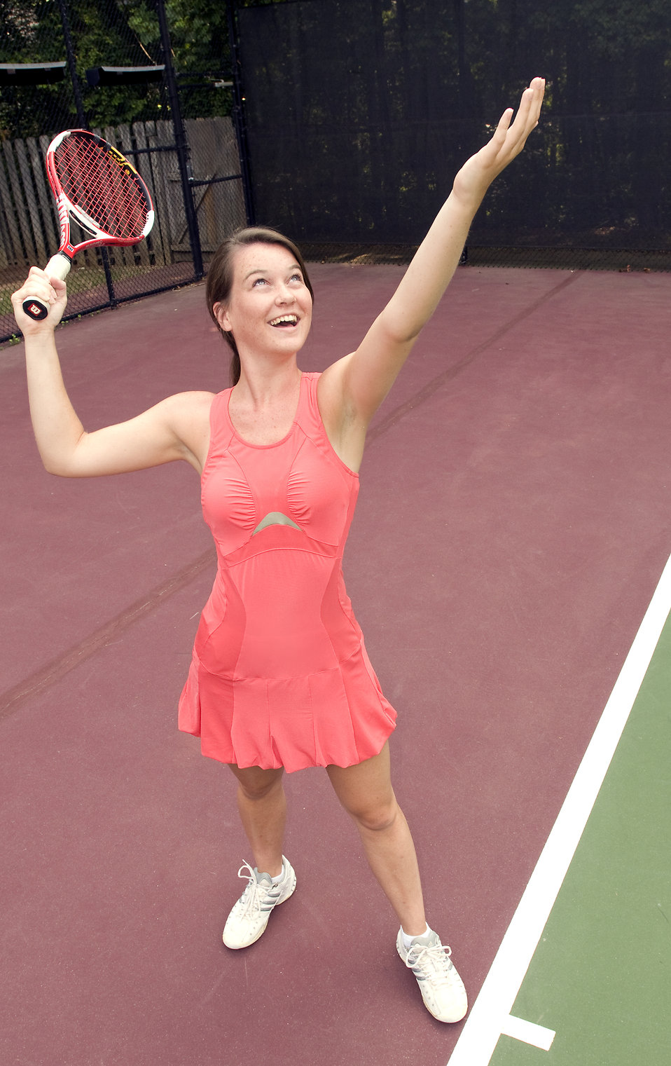 A young woman playing tennis : Free Stock Photo