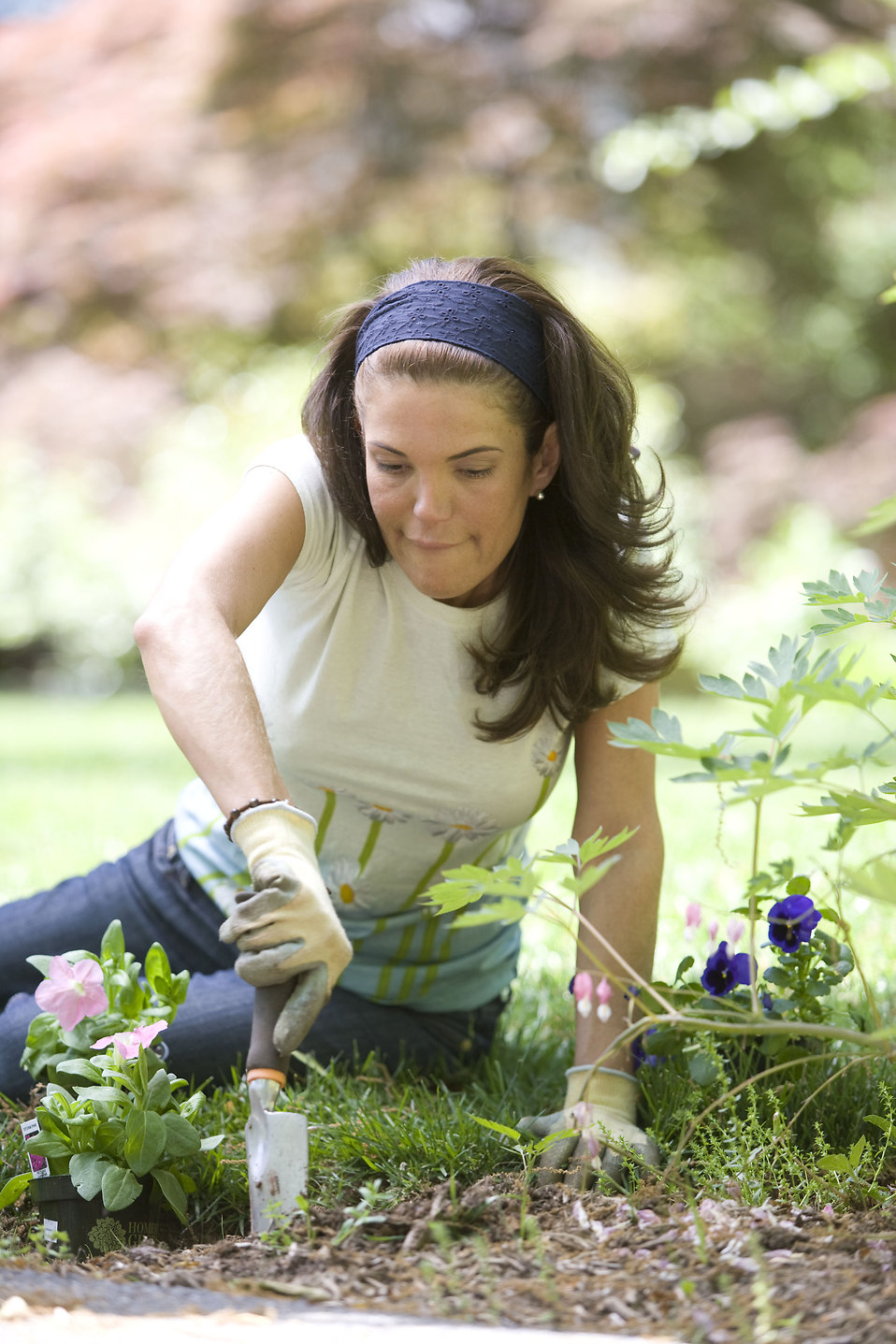 A woman enjoying gardening outdoors : Free Stock Photo
