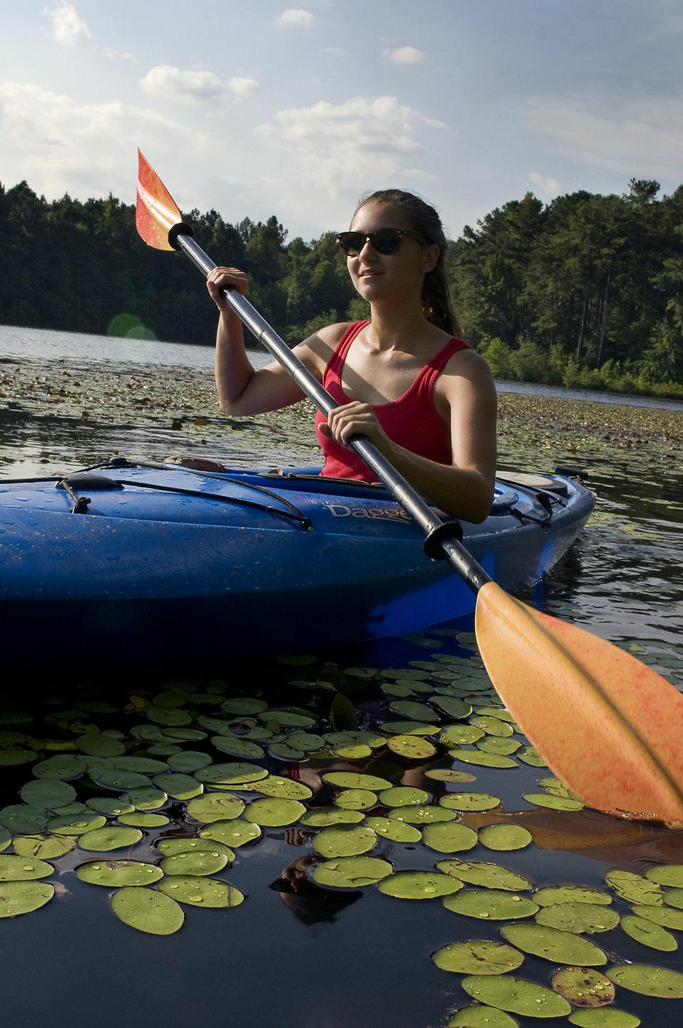 kayak free stock photo a young woman kayaking on a lake 16358
