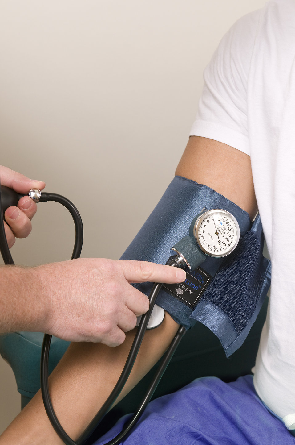 Close-up of a patient during a blood pressure examination : Free Stock Photo
