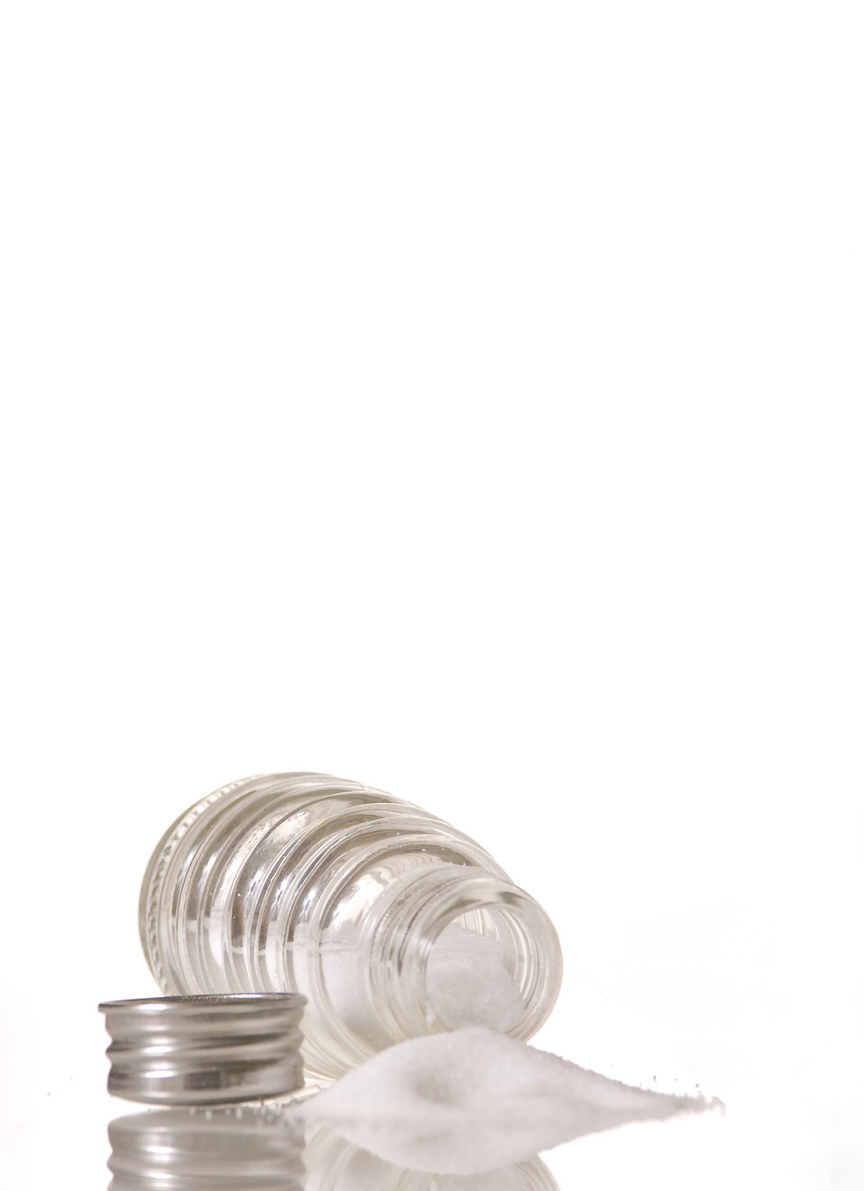 A spilled glass salt shaker : Free Stock Photo