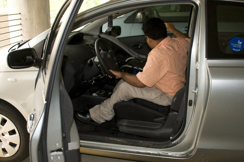 disabled free stock photo a man in a wheelchair getting out of a car 16392. Black Bedroom Furniture Sets. Home Design Ideas