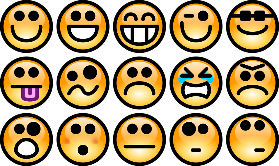Collection of orange smiley faces : Free Stock Photo