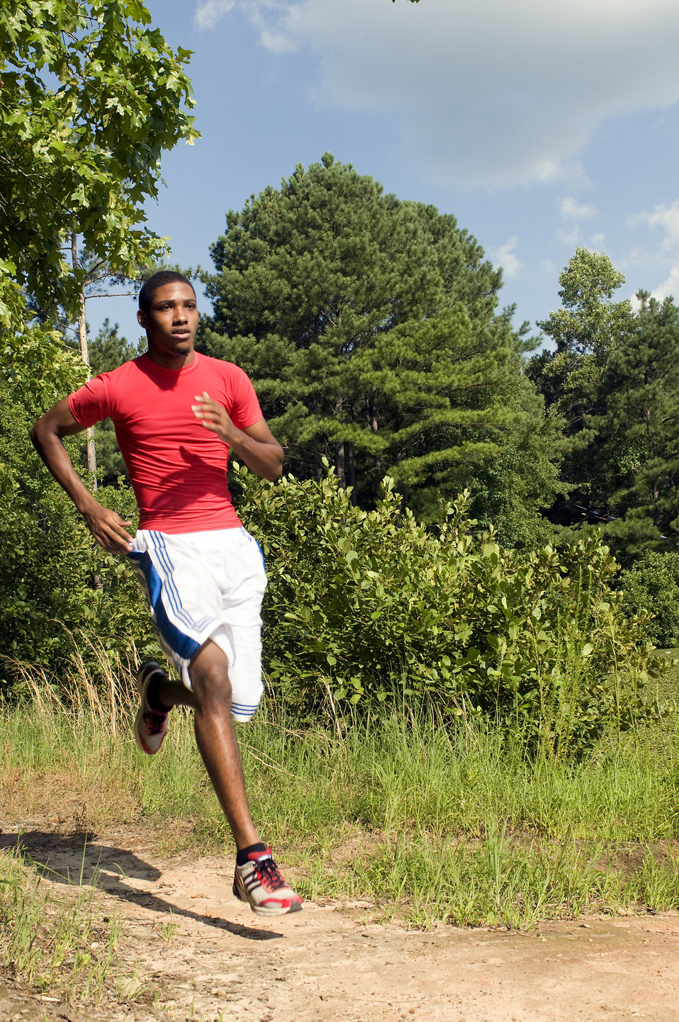An African American man jogging outdoors : Free Stock Photo