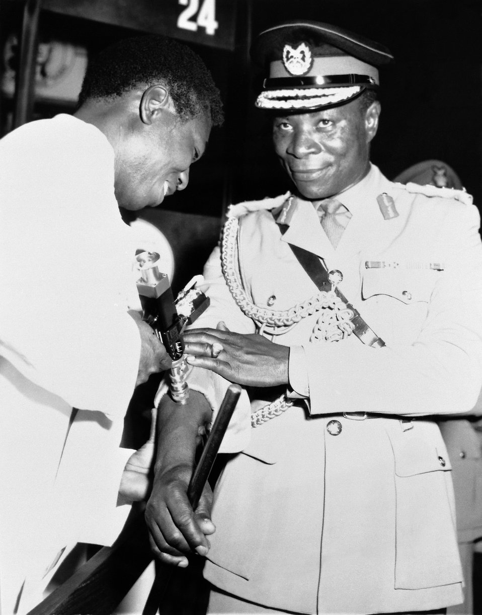 A Ghanan official receiving a smallpox vaccination shot : Free Stock Photo
