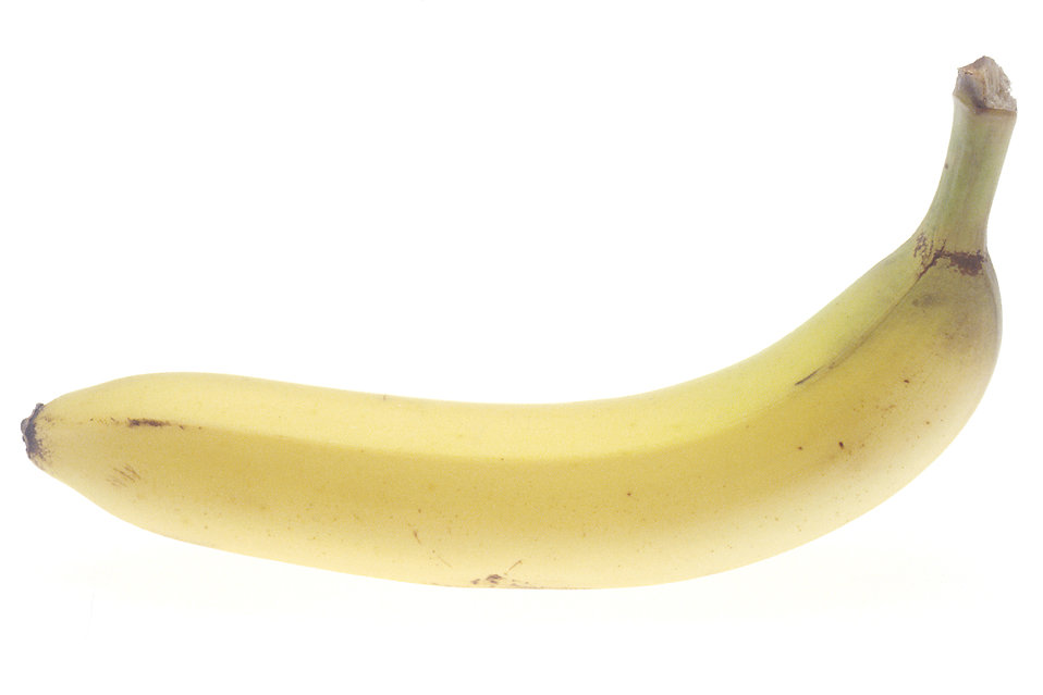 A banana isolated on a white background : Free Stock Photo