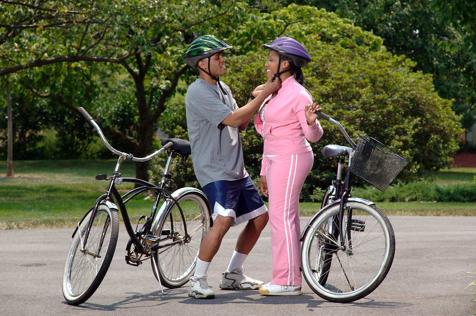 An African-American couple preparing for bike ride : Free Stock Photo