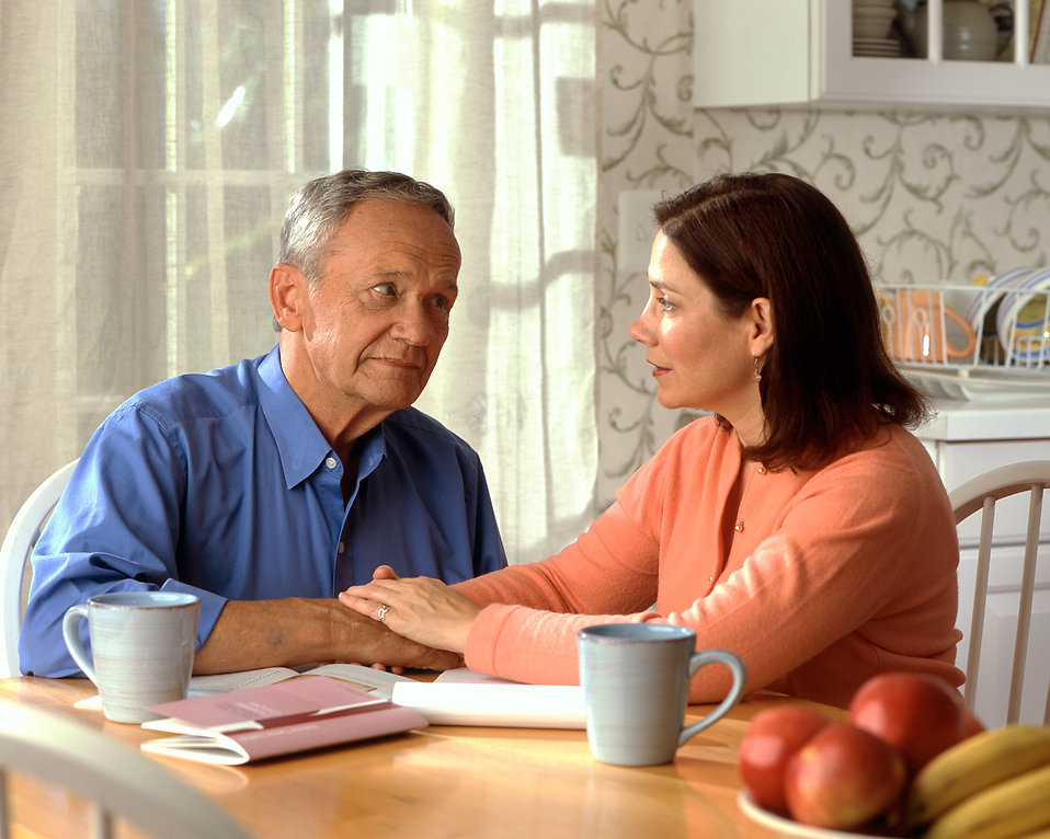 A woman and older man sitting at a table : Free Stock Photo