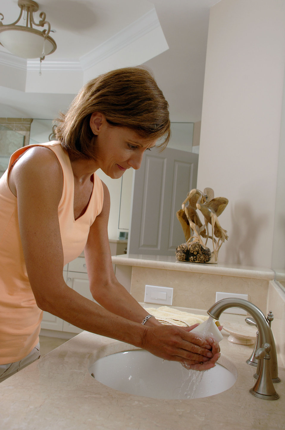 A woman washing her hands : Free Stock Photo