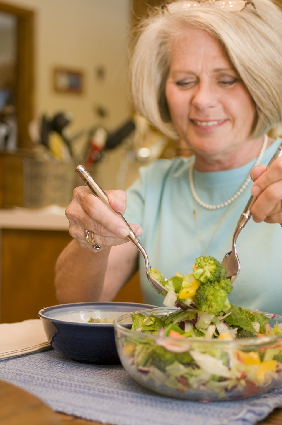 A woman eating a fresh salad : Free Stock Photo