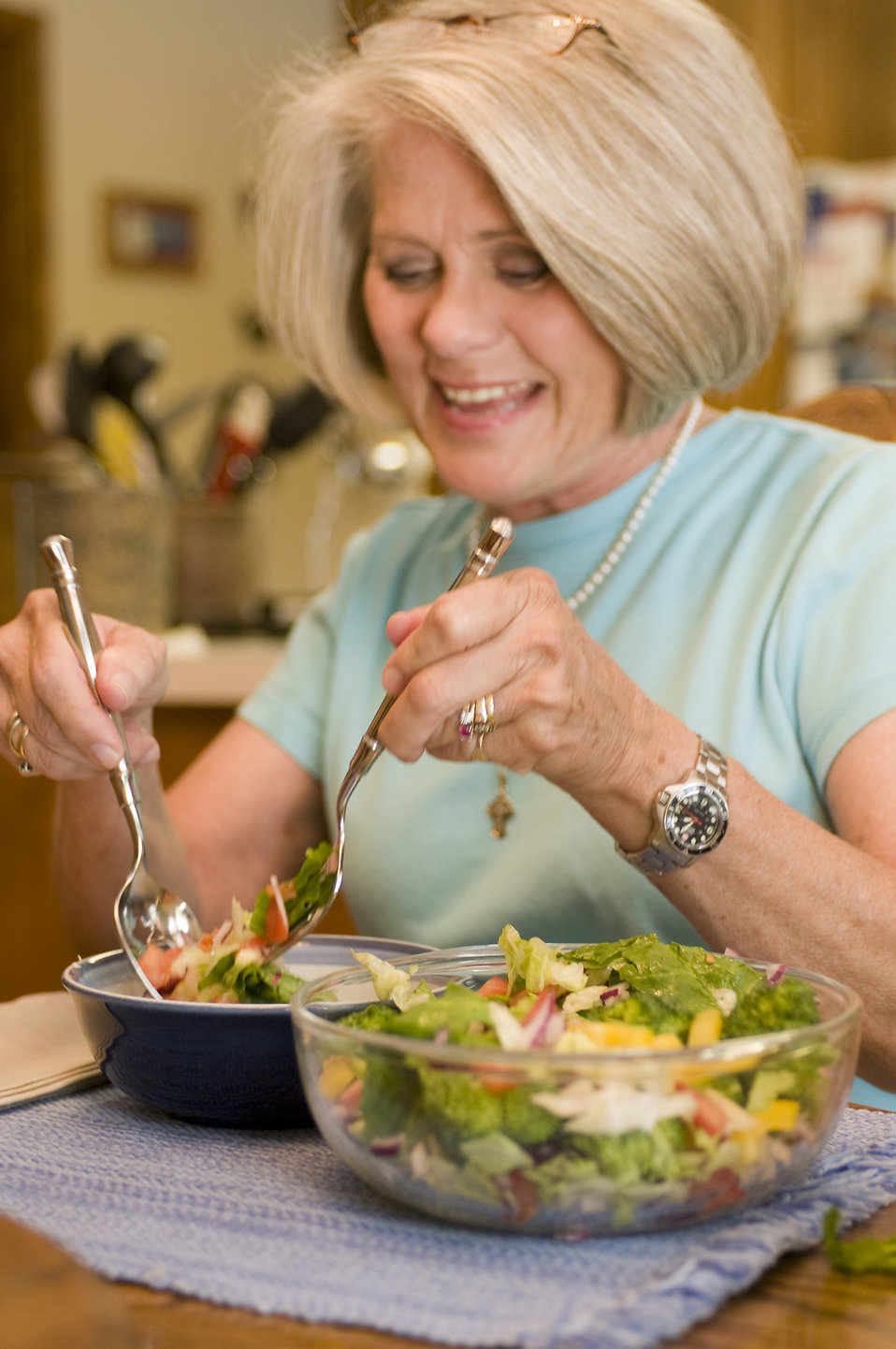 A woman eating a fresh salad : Free Stock Photo