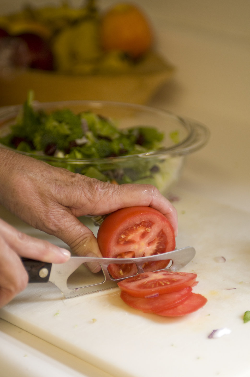 Preparing a salad in a kitchen : Free Stock Photo