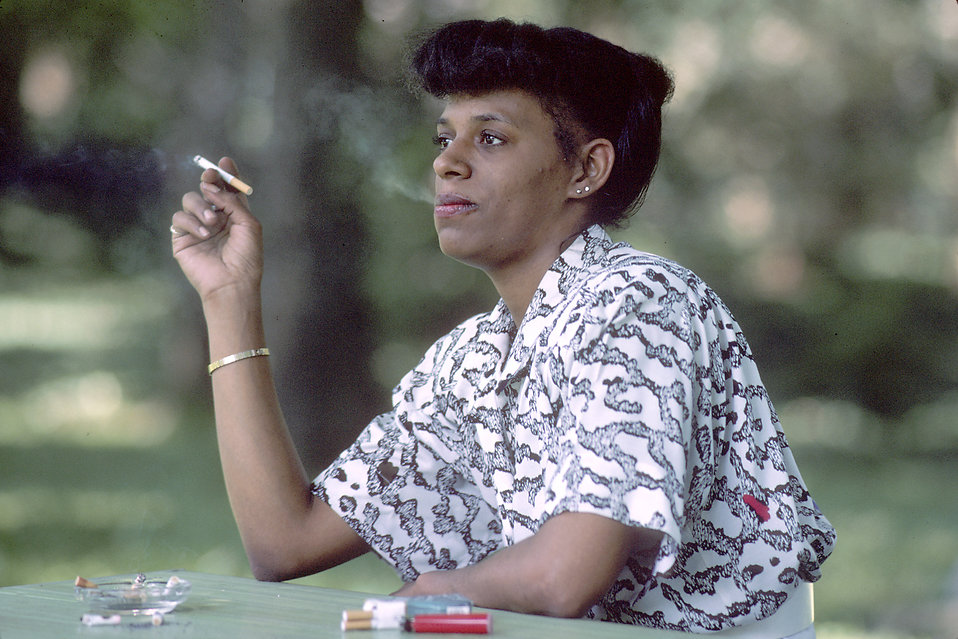 An African American woman smoking a cigarette : Free Stock Photo