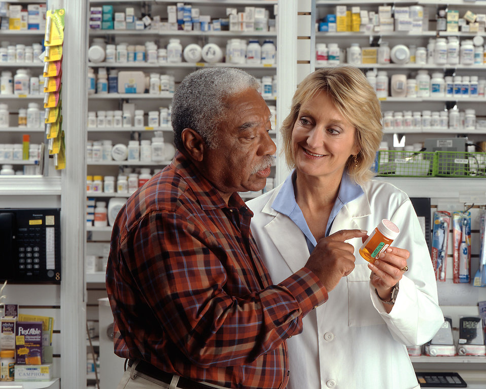 A man consulting his pharmacist : Free Stock Photo