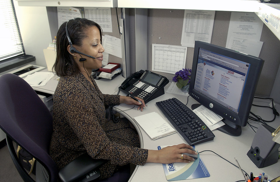 An African American woman working at her desk : Free Stock Photo
