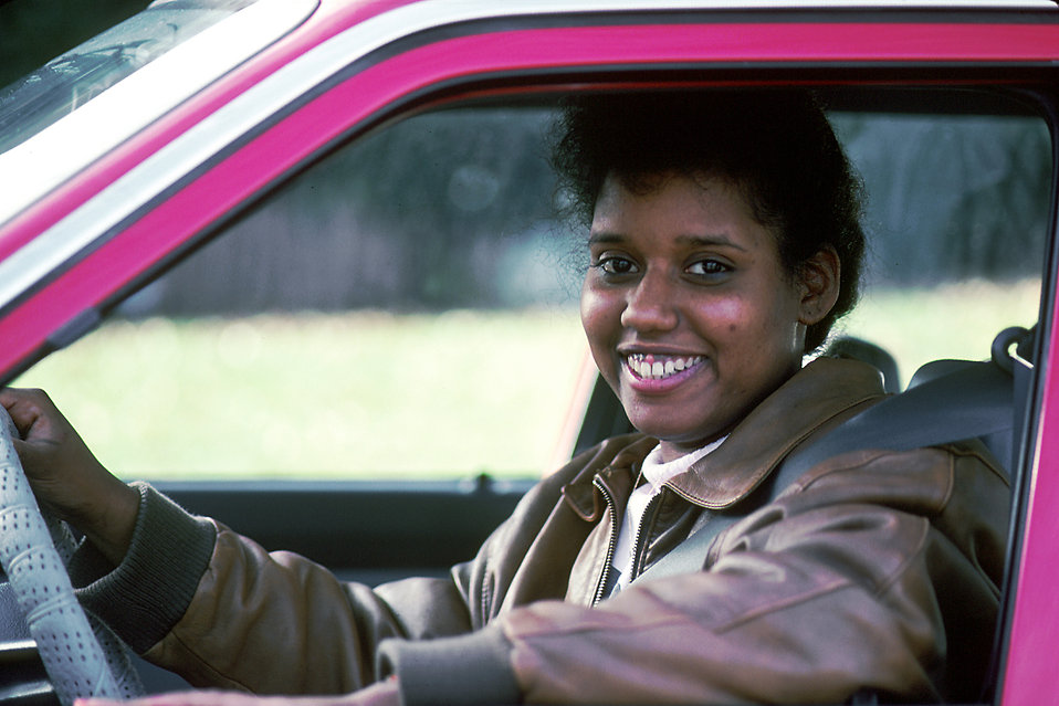 An African American woman driving : Free Stock Photo