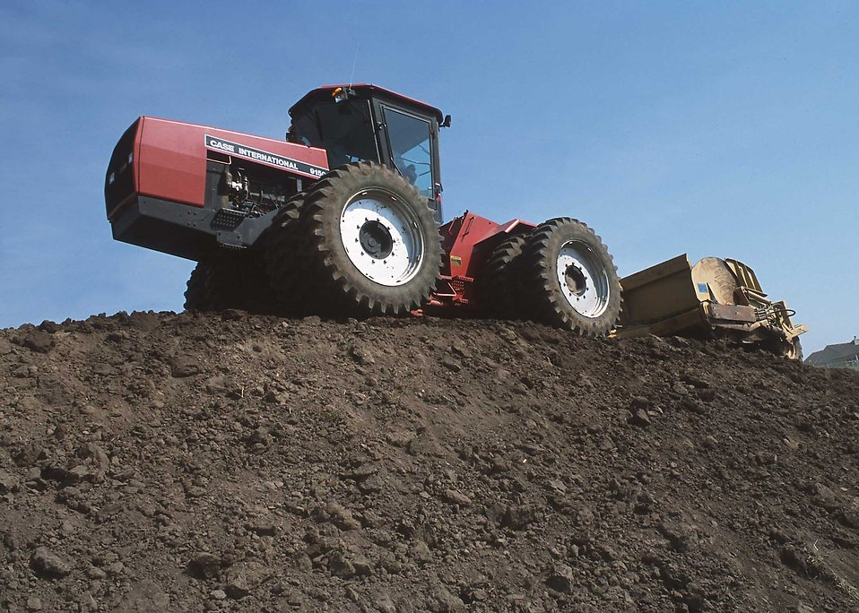 A tractor moving topsoil on a hill : Free Stock Photo