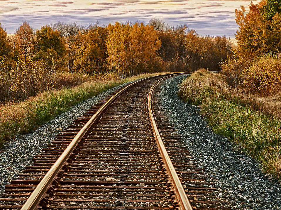 ... An HDR image of an isolated stretch of railroad track on a fall day