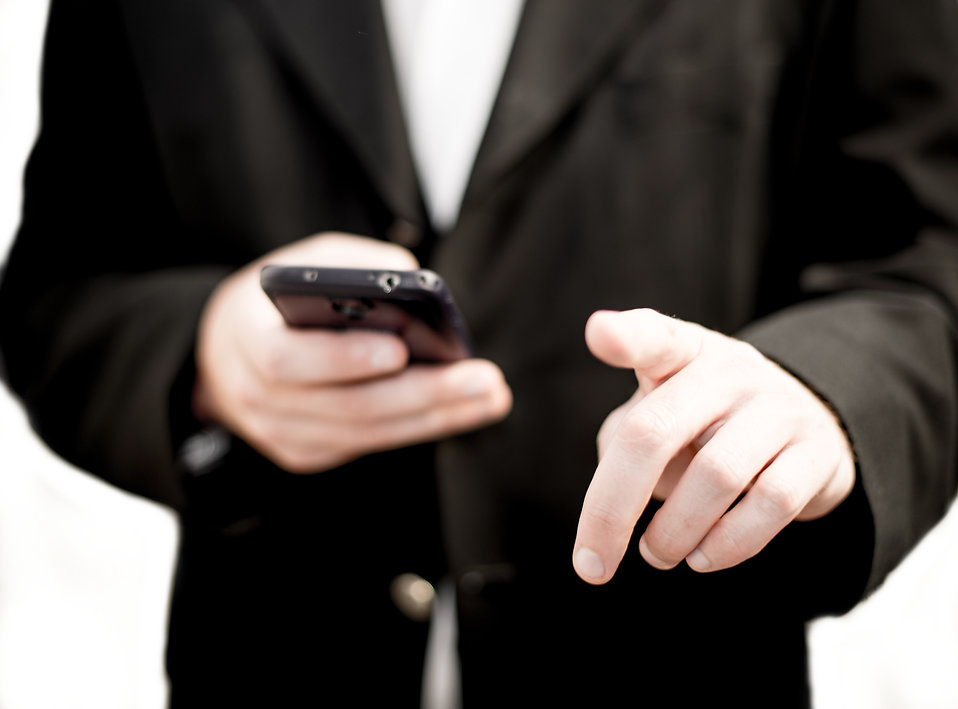 Business man holding a cell phone : Free Stock Photo