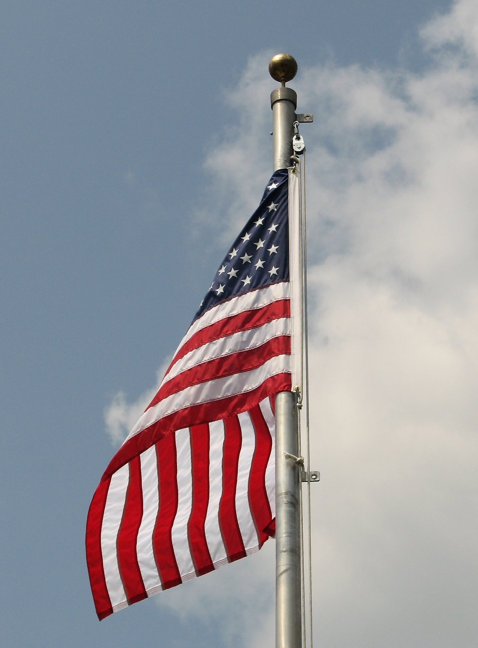 American flag on a flag pole : Free Stock Photo